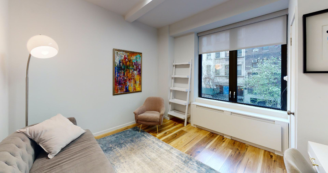 psychotherapy office with white walls and wood floors in NYC